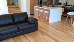 Coloured matai flooring coated in a matte waterbased polyurethane